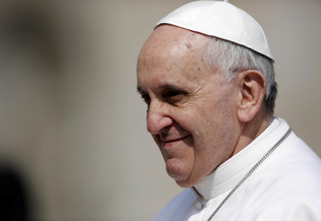 Pope Francis is driven through the crowd during his general audience, in St. Peter's Square, at the Vatican, Wednesday, March 27, 2013. (AP Photo/Andrew Medichini)